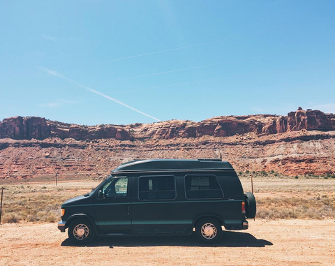 Side view of van against a desert landscape