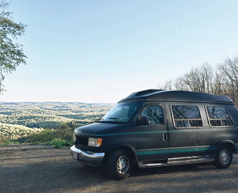 Black van against picturesque mountain landscape