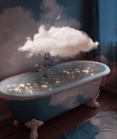 A claw footed bathtub filled with sparkly water and a cloud hovering above it