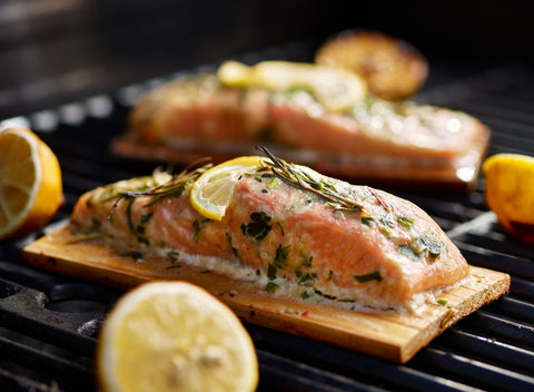 Salmon with rosemary and lemon on the grill