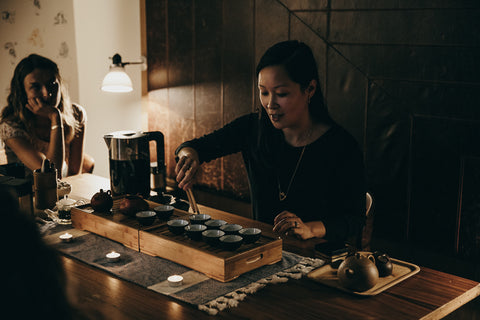 Woman performing traditional tea ceremony