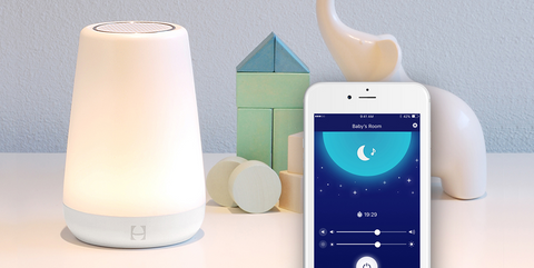 White noise machine and iPhone app screen to show light and noise controls
