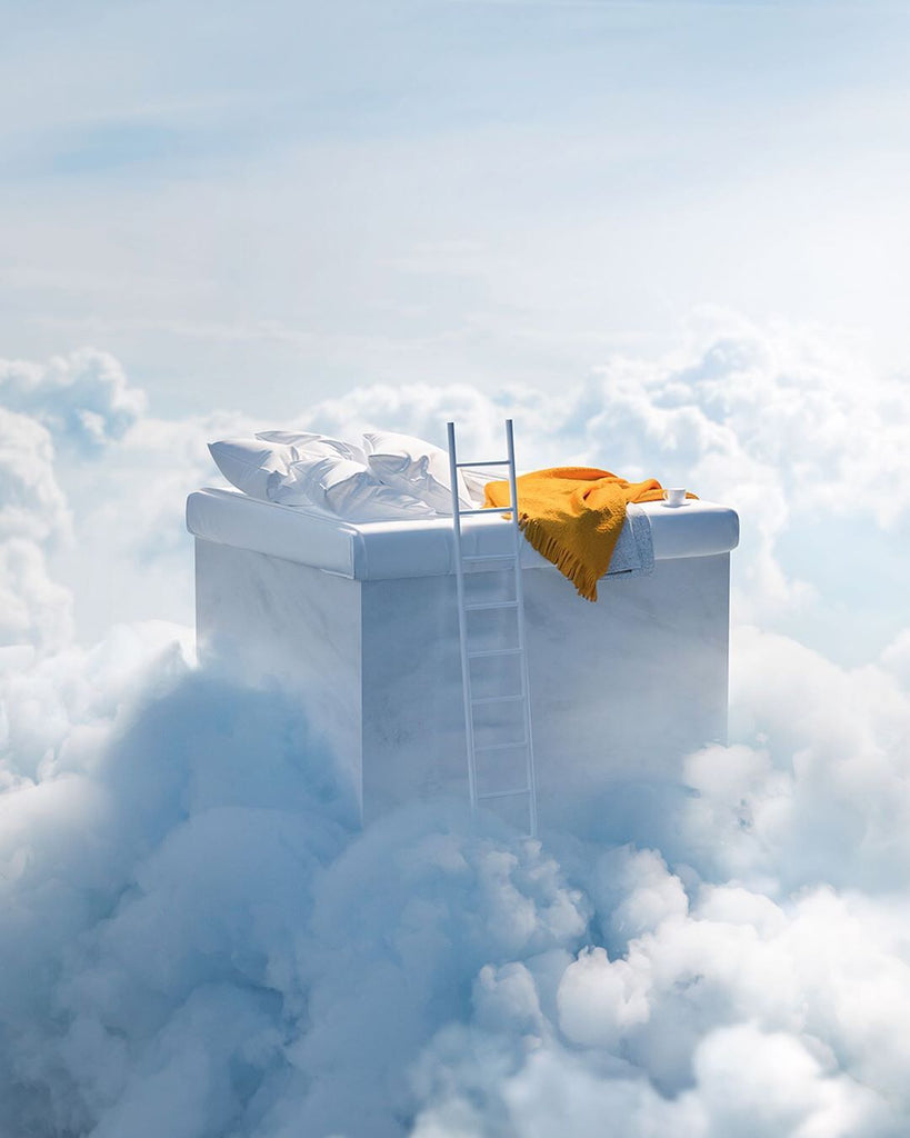 Elevated computer generated bed in the clouds with a ladder and yellow blanket.