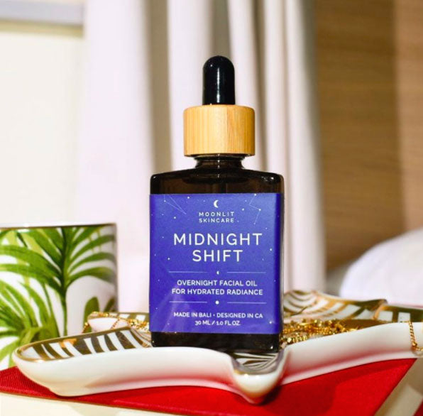 Front view of Midnight Shift Overnight Facial Oil bottle with wooden detail and rubber dropper.