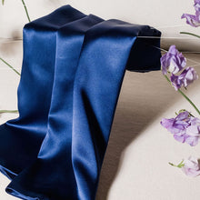 'Cloud 9' Night Sky Navy Blue Silk Pillowcase draped across foreground with purple flowers