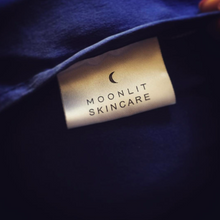 Close-up of Moonlit Skincare tag sewn on to 'Cloud 9' pillowcase in Night Sky Navy.