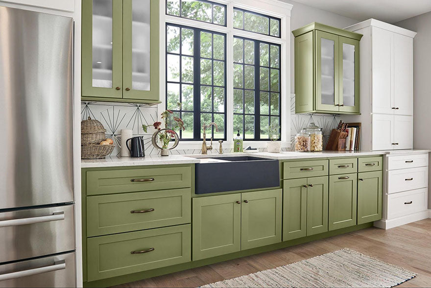 green and white cabinets in kitchen