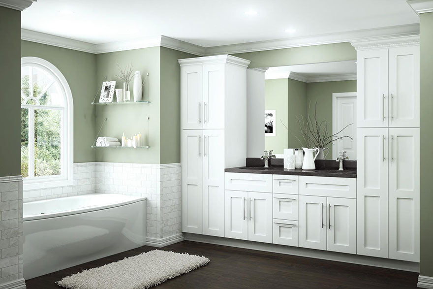 bright neutral bathroom with white cabinets