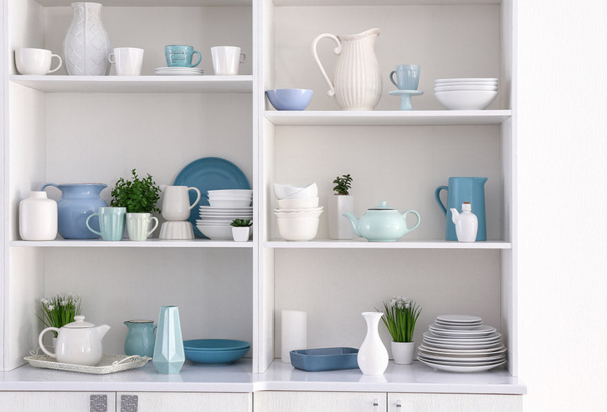 open cupboard with clean dishes