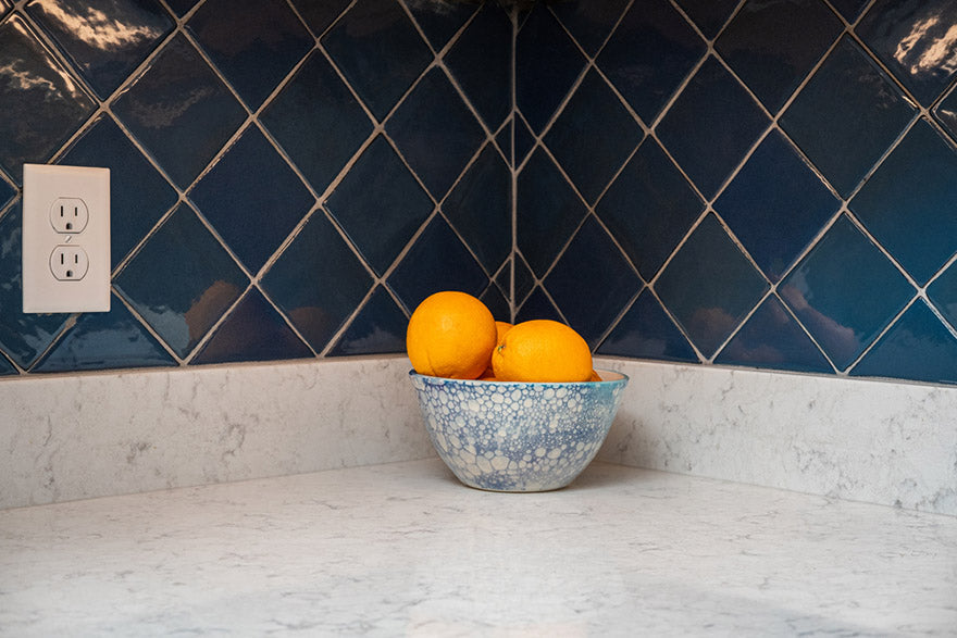 oranges in a blue and white bowl