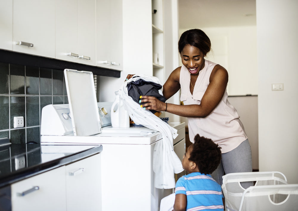 son helping mom do the laundry