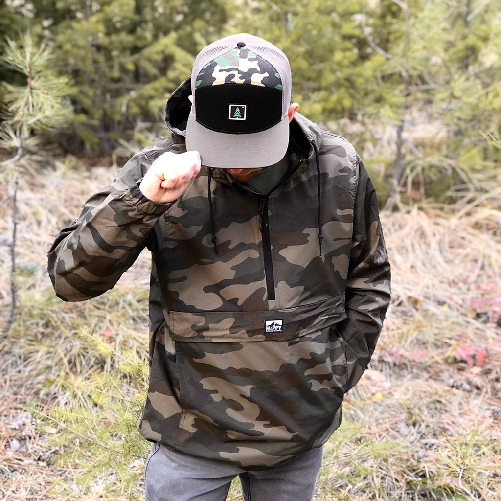 Logo Label <br> Camo Rain Jacket - The Happy Clothing Company... Outdoor apparel with a cause.