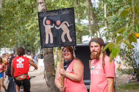 Harm Reduction Volunteers holding Consent Culture sign