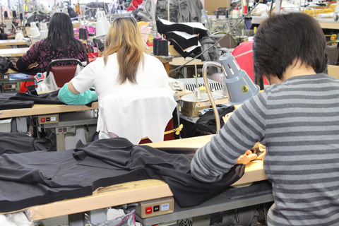 Seamsters at a factory in the USA sewing t-shirts and hoodies