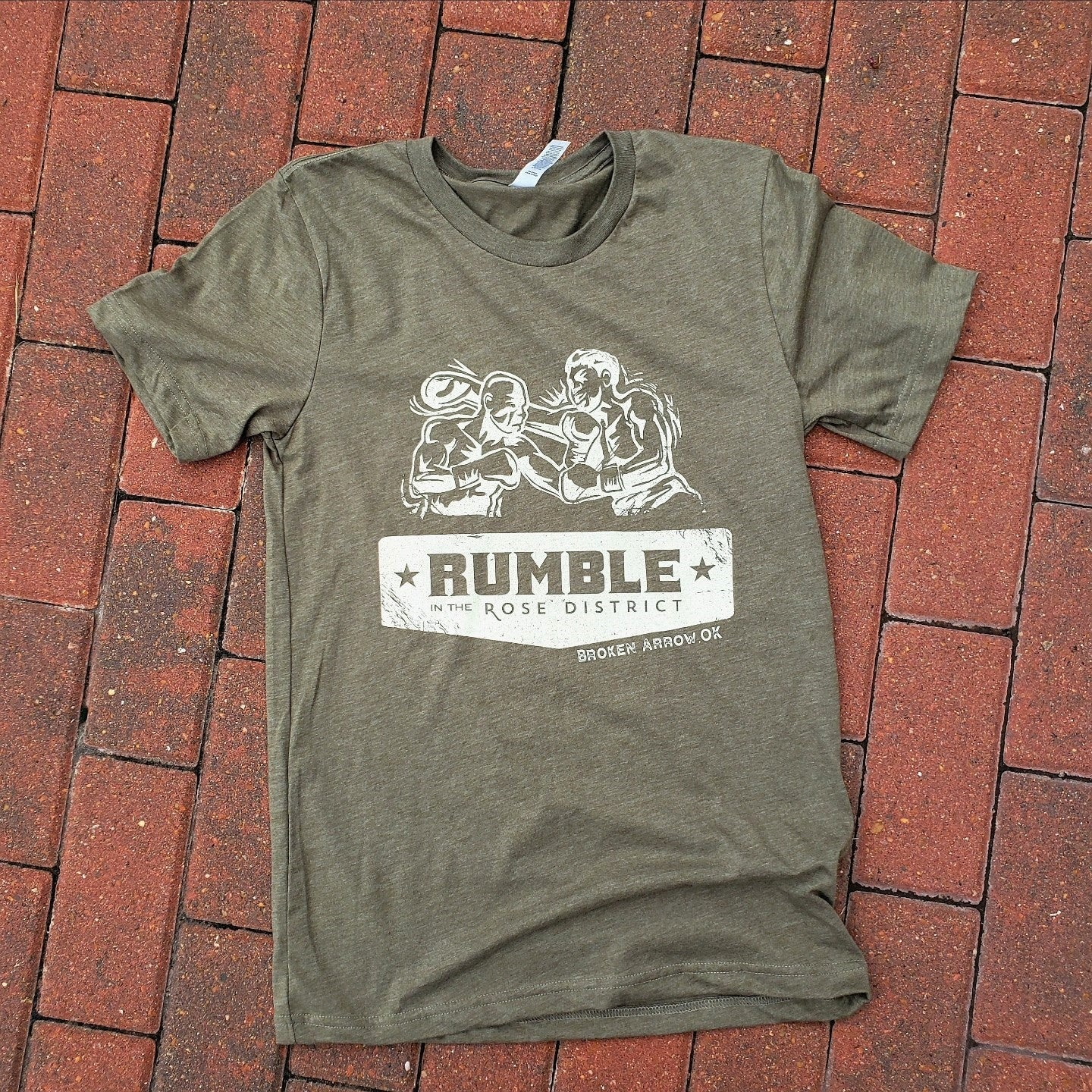 Rumble in the Rose District Official Heather Military Green Tee