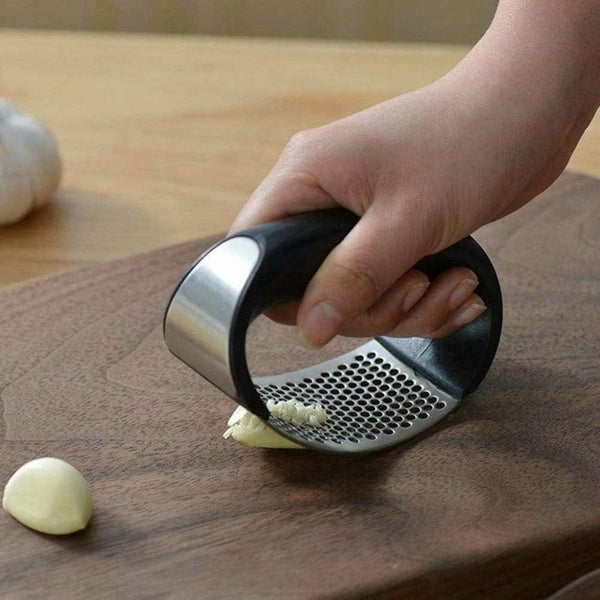 Adapted Garlic press