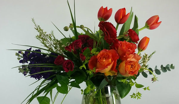 Tulips and Roses in a wildflower design make a great flower gift.