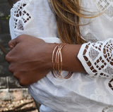 example of four stacked bangles on a models arm
