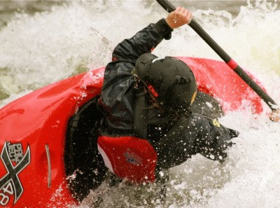 """Looking upstream Hayley Mills begins the rotation and body huck commitment to throw a """"Backstab."""" A backstab is executed from a backwards surf transitioning the kayak vertically to whip or cutback to a forward surf.  Impressive to watch!"""