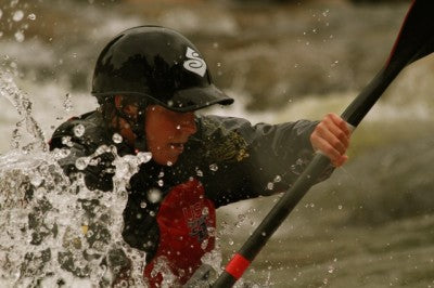 Hayley Mills trains at the downtown Salida Whitewater Park.  Above she sets up with a surf to execute a high-level wave helix.