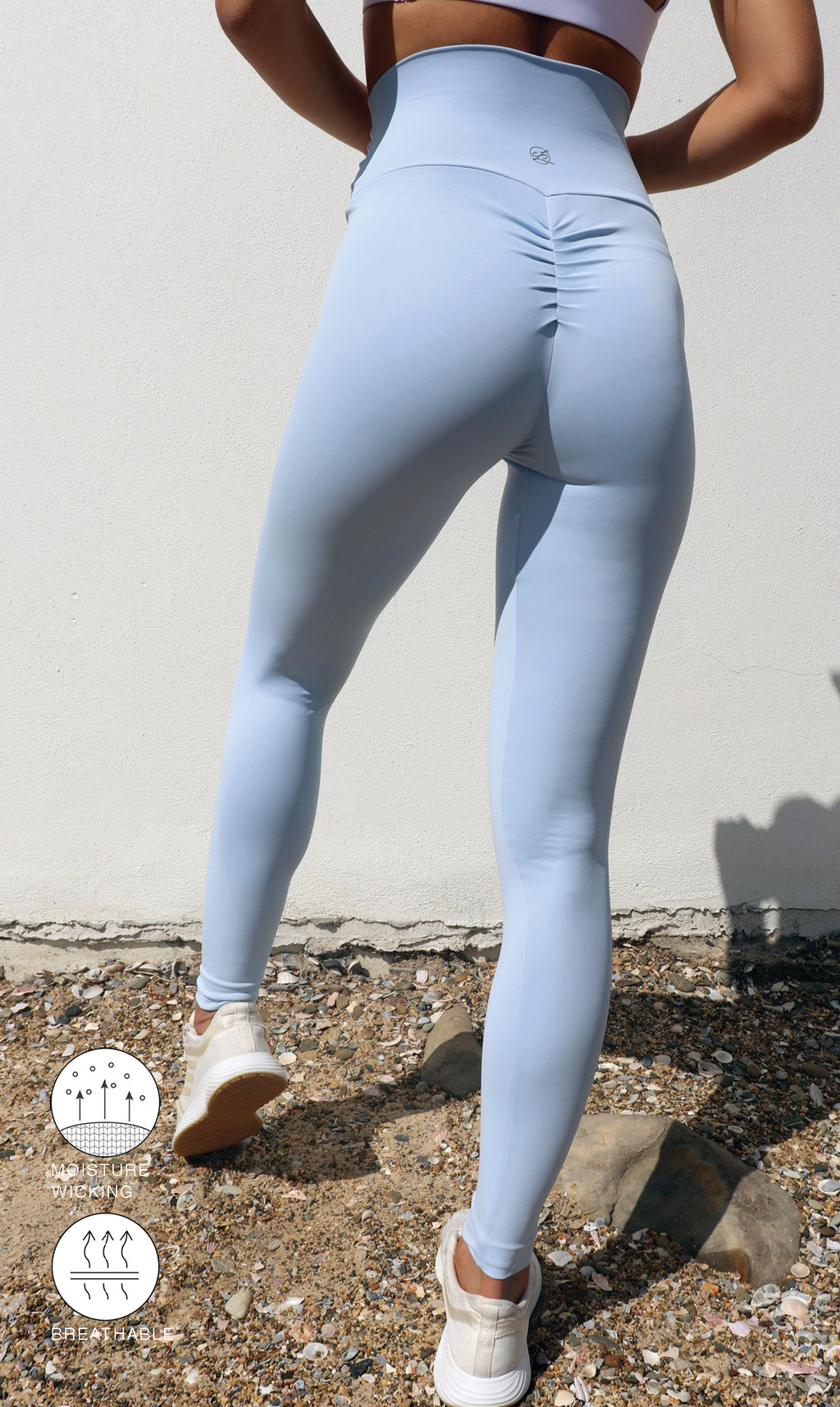 Rear view: Girl in ultra high waist, blue cloud body luxe scrunch bum leggings