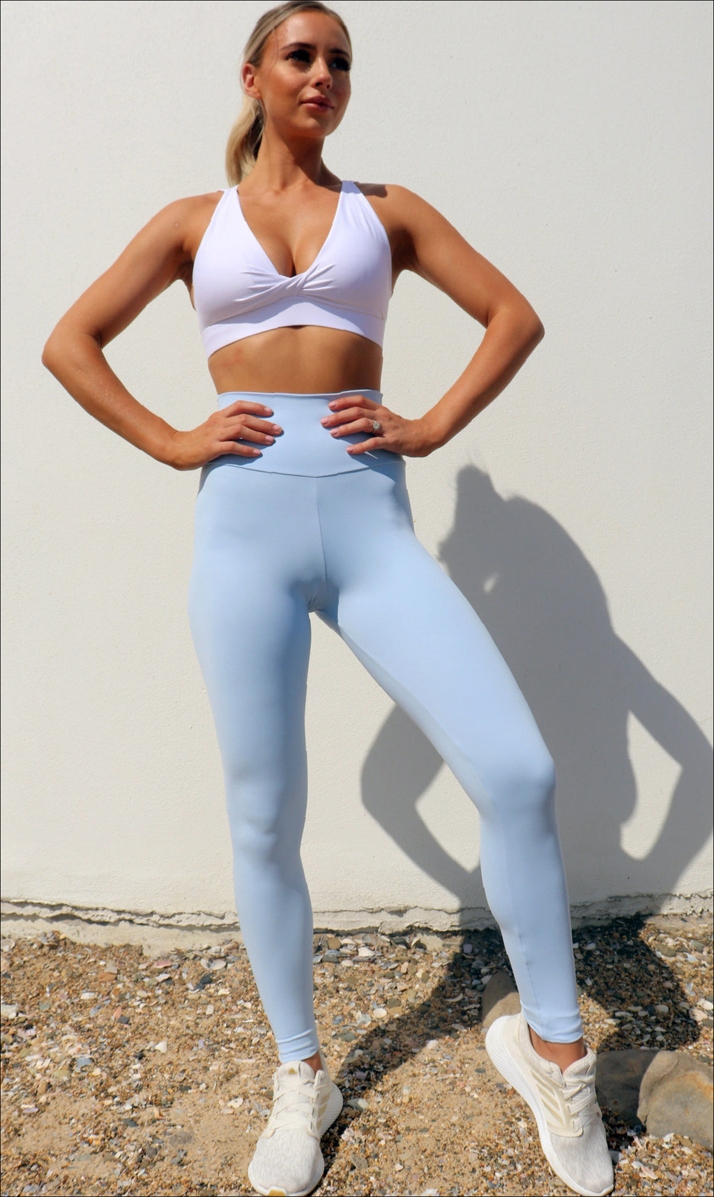 Girl in ultra high waist, blue cloud body luxe scrunch bum leggings & white diamond back bra