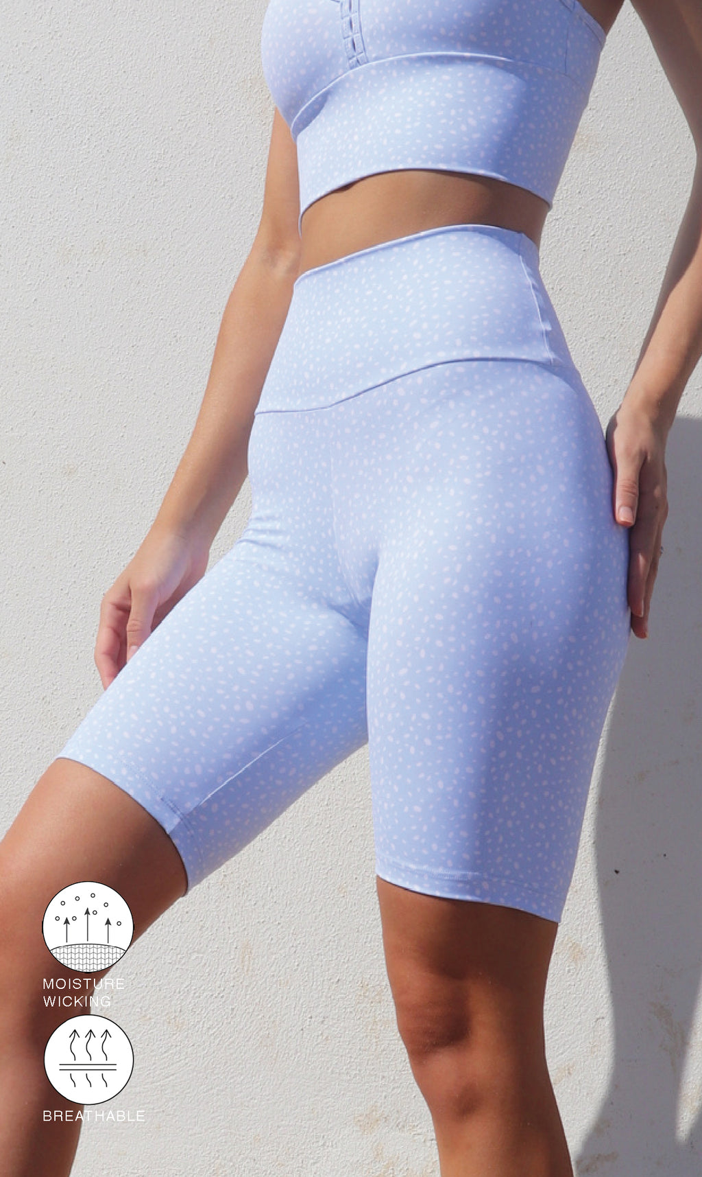 Girl in white & blue cloud star dust print body luxe high waist biker shorts & racer back bra