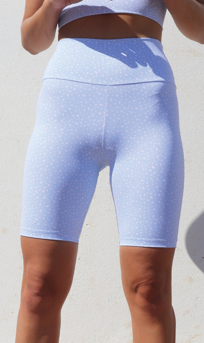 Close up: Girl in white & blue cloud star dust print body luxe high waist biker shorts