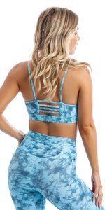 Rear view of girl wearing blue tie dye blue crush print momentum bra with three horizontal back straps & matching ultra high waist leggings