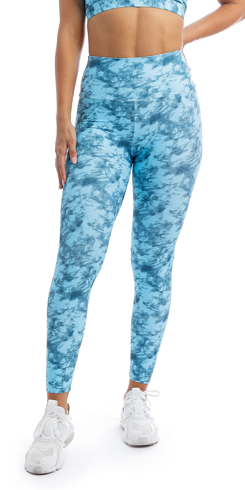 Front view of girl wearing blue tie dye blue crush print ultra high waist leggings & matching racer bra