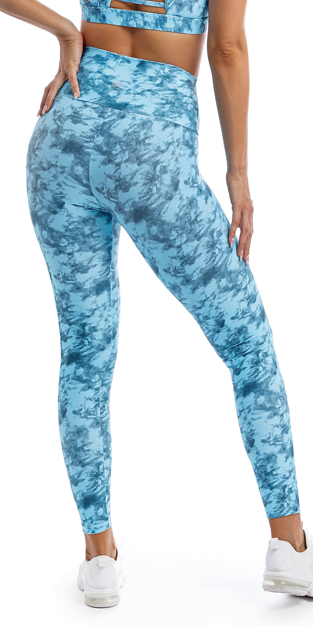 Rear view of girl wearing blue tie dye blue crush print ultra high waist leggings & matching momentum bra