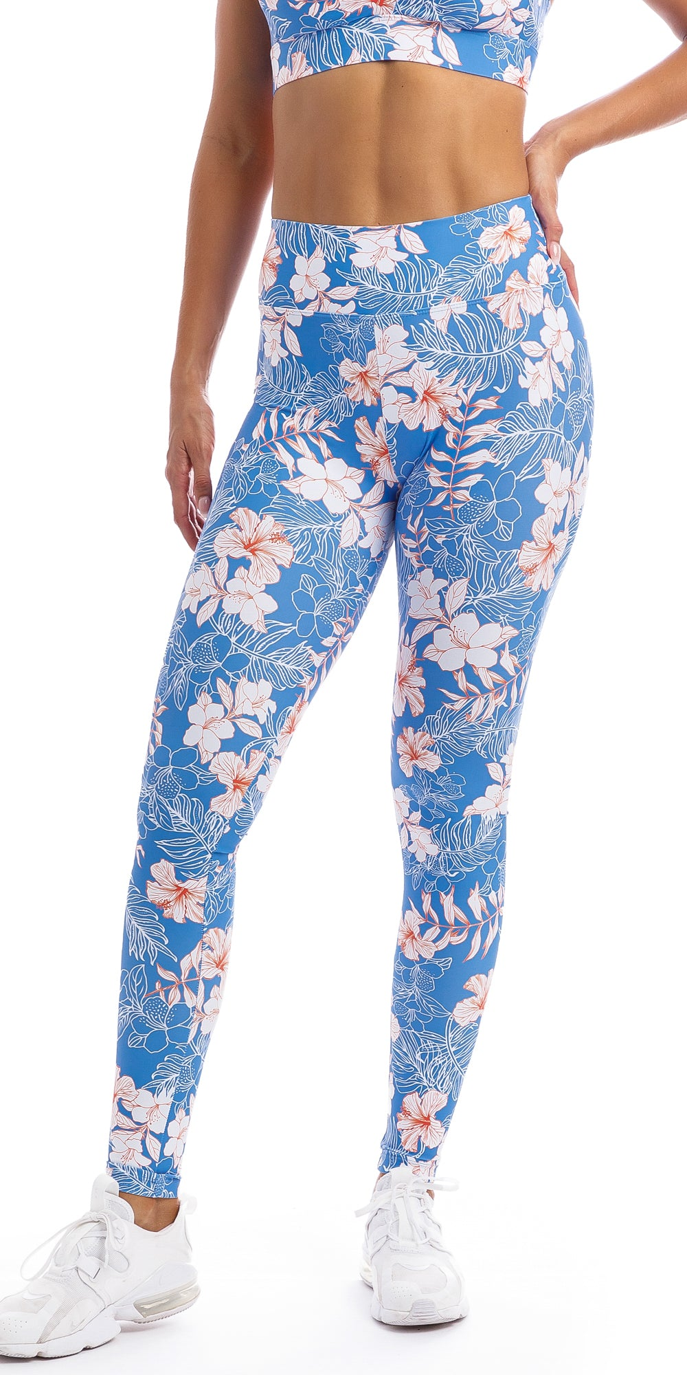 Lady wearing blue, white, pink floral Hibiscus Kiss print extra long leggings & matching diamond back bra