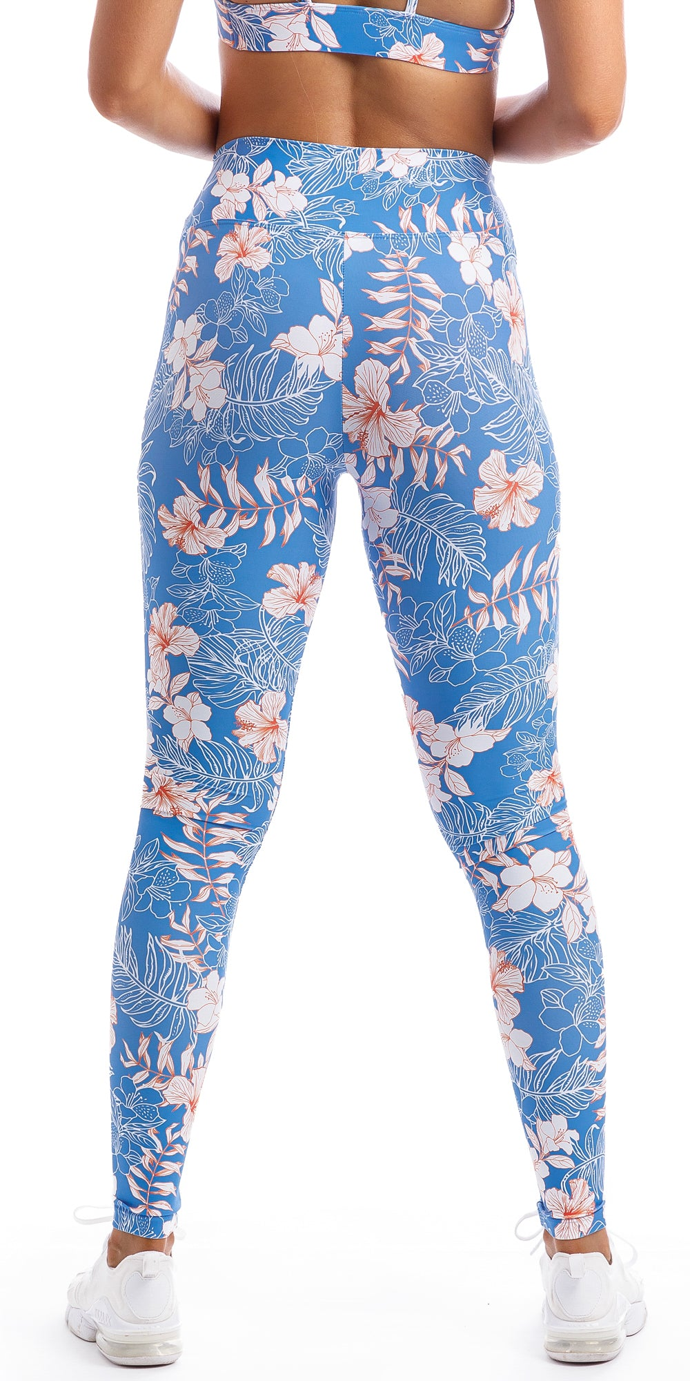 Rear view of lady wearing blue, white, pink floral Hibiscus Kiss print extra long leggings & matching diamond back bra