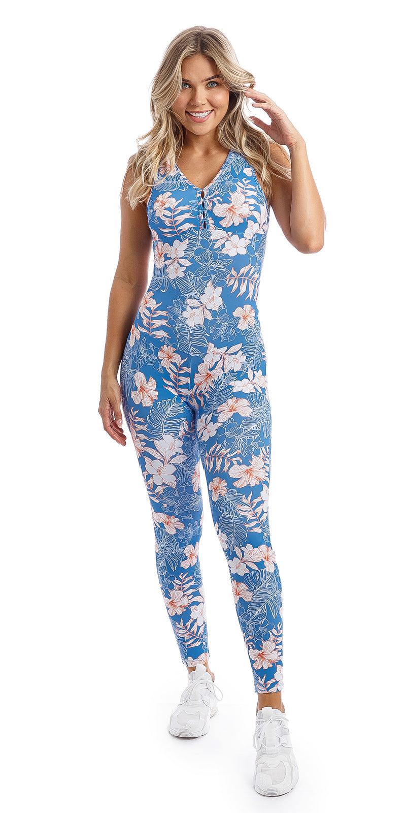 Lady in sleeveless blue, white and pink hibiscus flower print unitard with crisscross back detailing