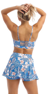 Rear view of lady wearing blue, white, pink floral Hibiscus Kiss print skort & matching momentum bra
