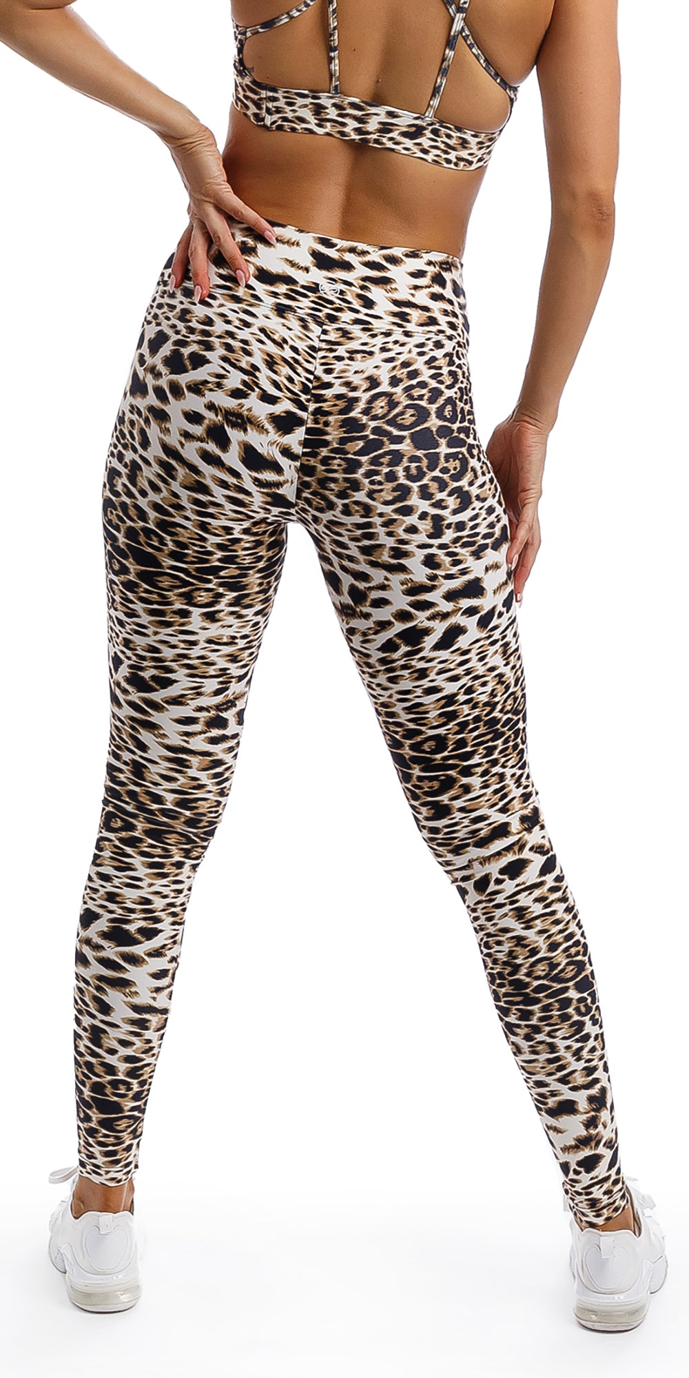 Rear view of lady wearing brown and white cheetah print extra long leggings & matching diamond back bra