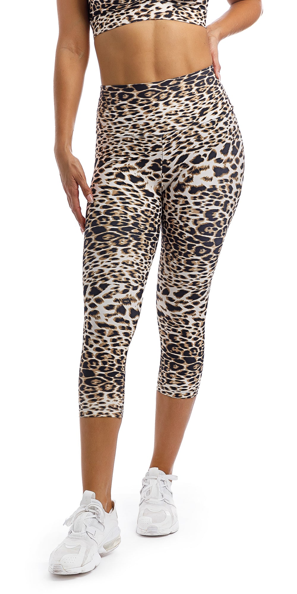 Girl wearing brown & white cheetah print capri leggings & matching infinity bra