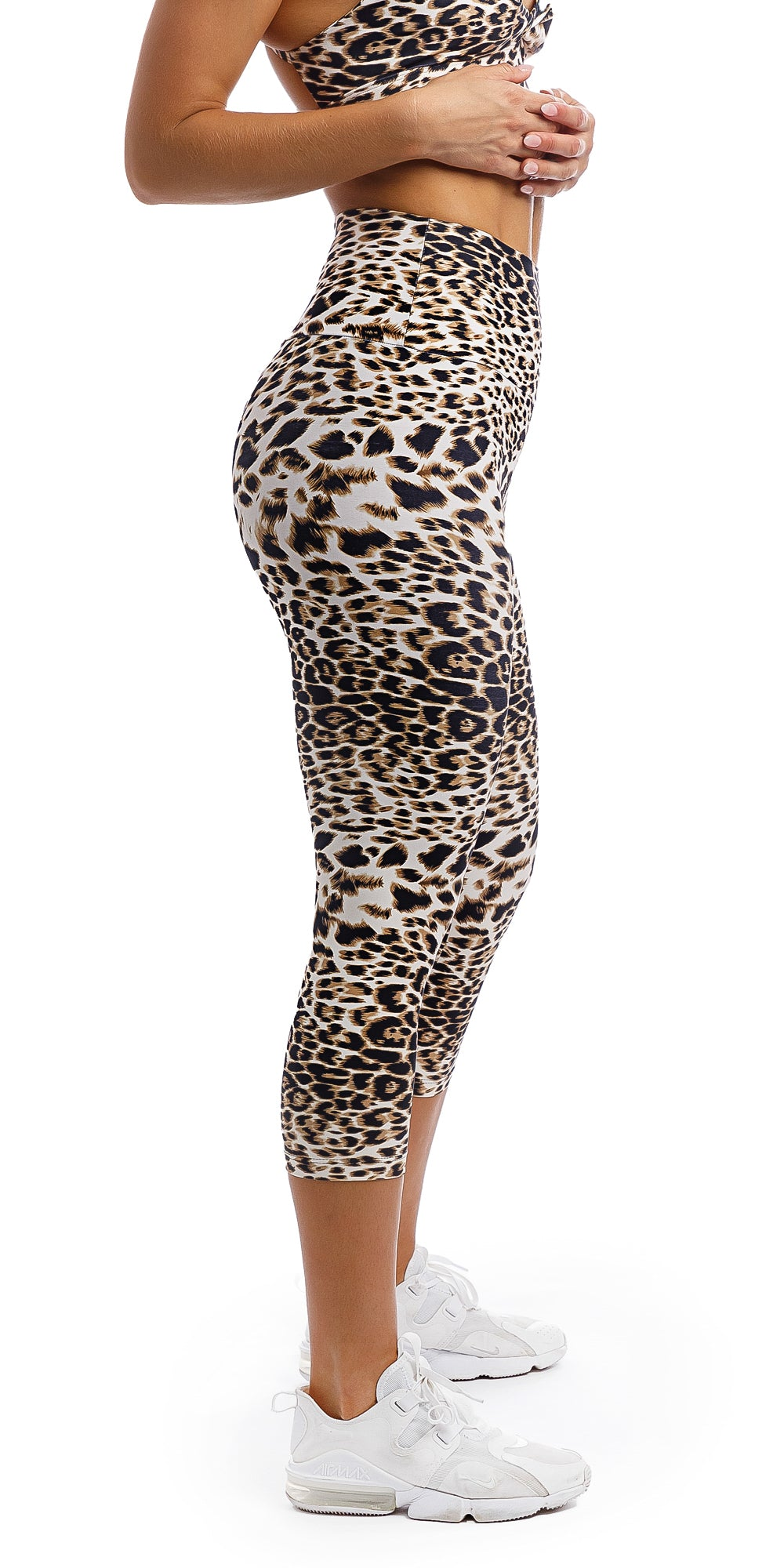 Side view of girl wearing brown & white cheetah print capri leggings & matching infinity bra