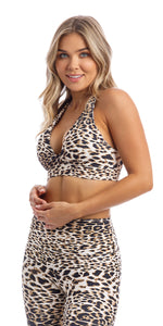 Girl wearing brown & white cheetah print infinity bra with cross-over back straps & matching capri leggings