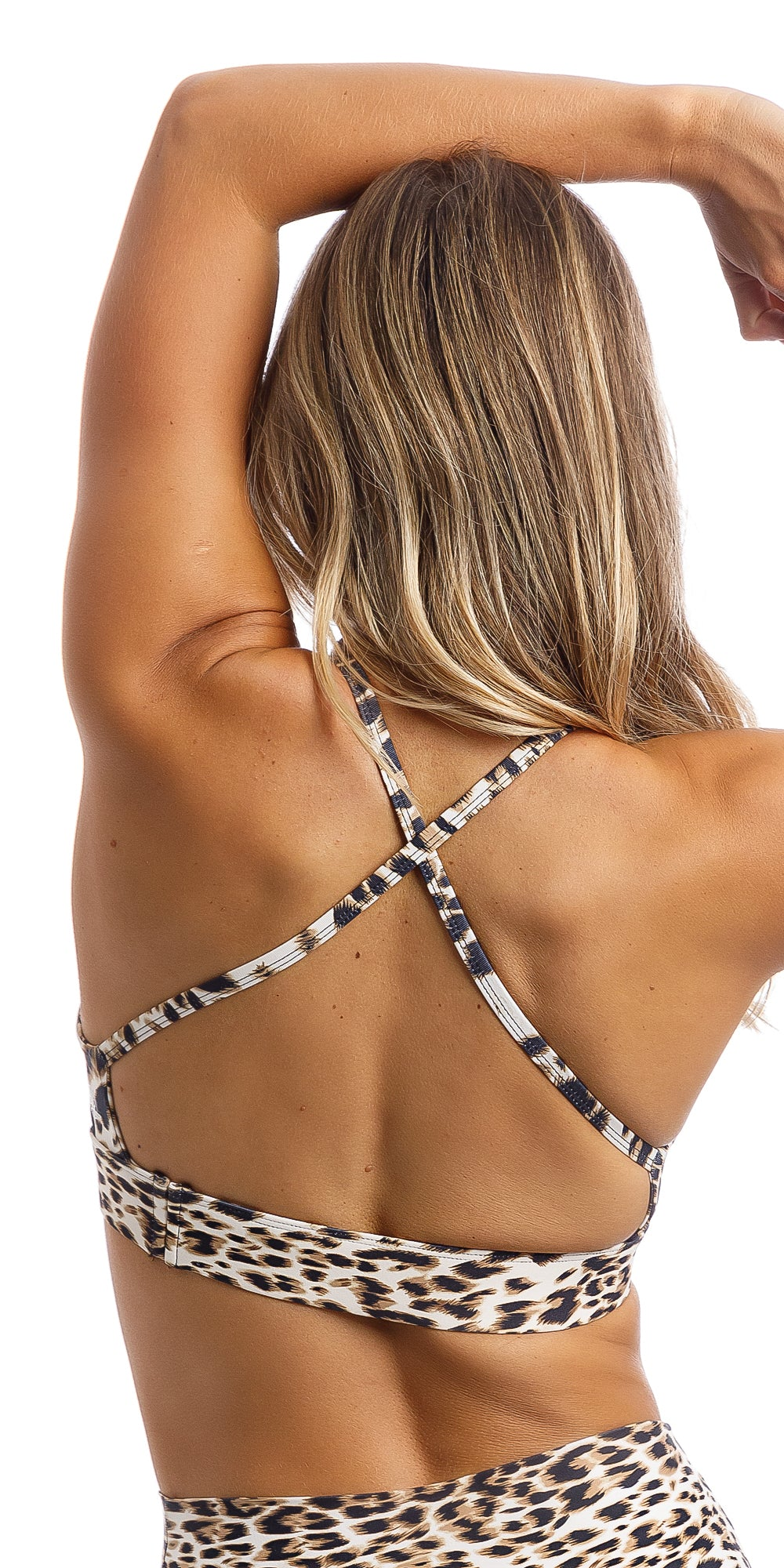 Rear view of girl wearing brown & white cheetah print infinity bra with cross-over back straps & matching capri leggings