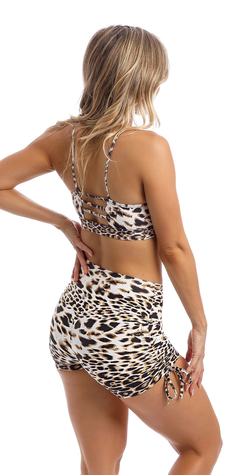 Girl with hand on hip wearing brown & white cheetah print bootie shorts & matching momentum bra