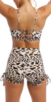 Girl wearing brown & white cheetah print bootie shorts & matching momentum bra