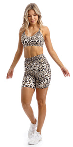 Girl wearing brown & white cheetah print midi shorts with pockets & matching momentum bra