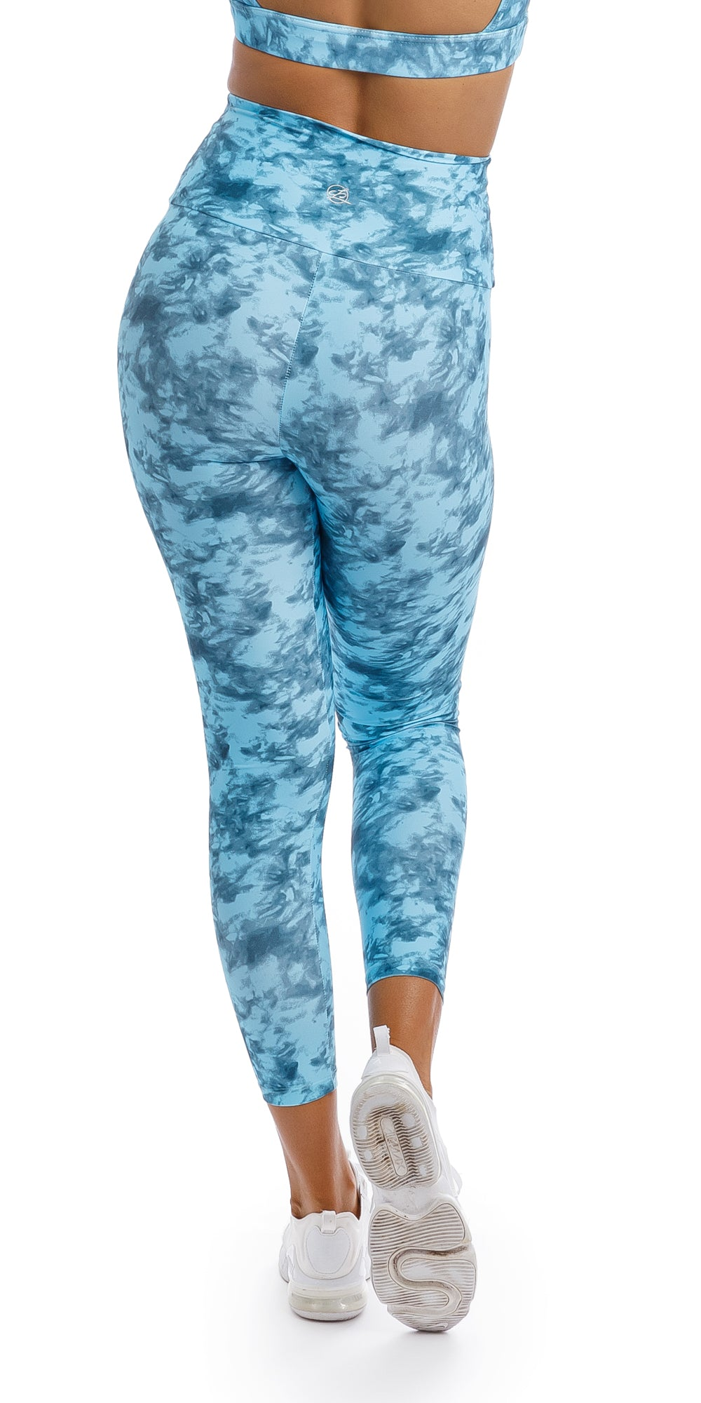 Girl wearing blue tie dye blue crush print ultra high waist 7/8 leggings & matching rhythm bra