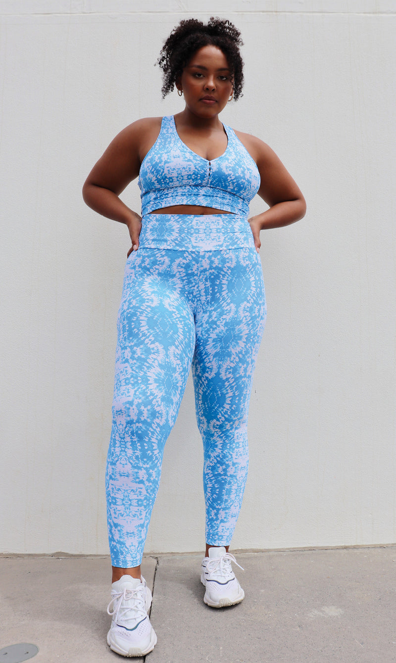 Girl wearing white & blue Electric Tie Dye ultra high waist leggings & matching racer back bra
