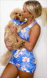 Girl wearing Hibiscus Kiss set, holding her puppy in a matching Hibiscus Kiss doggy bandana