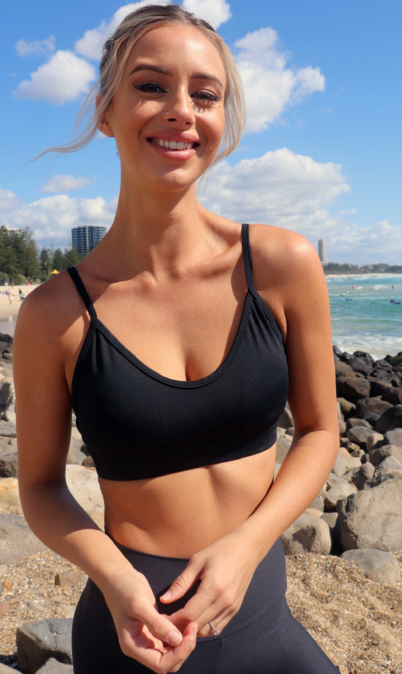Lady on beach in midnight momentum bra