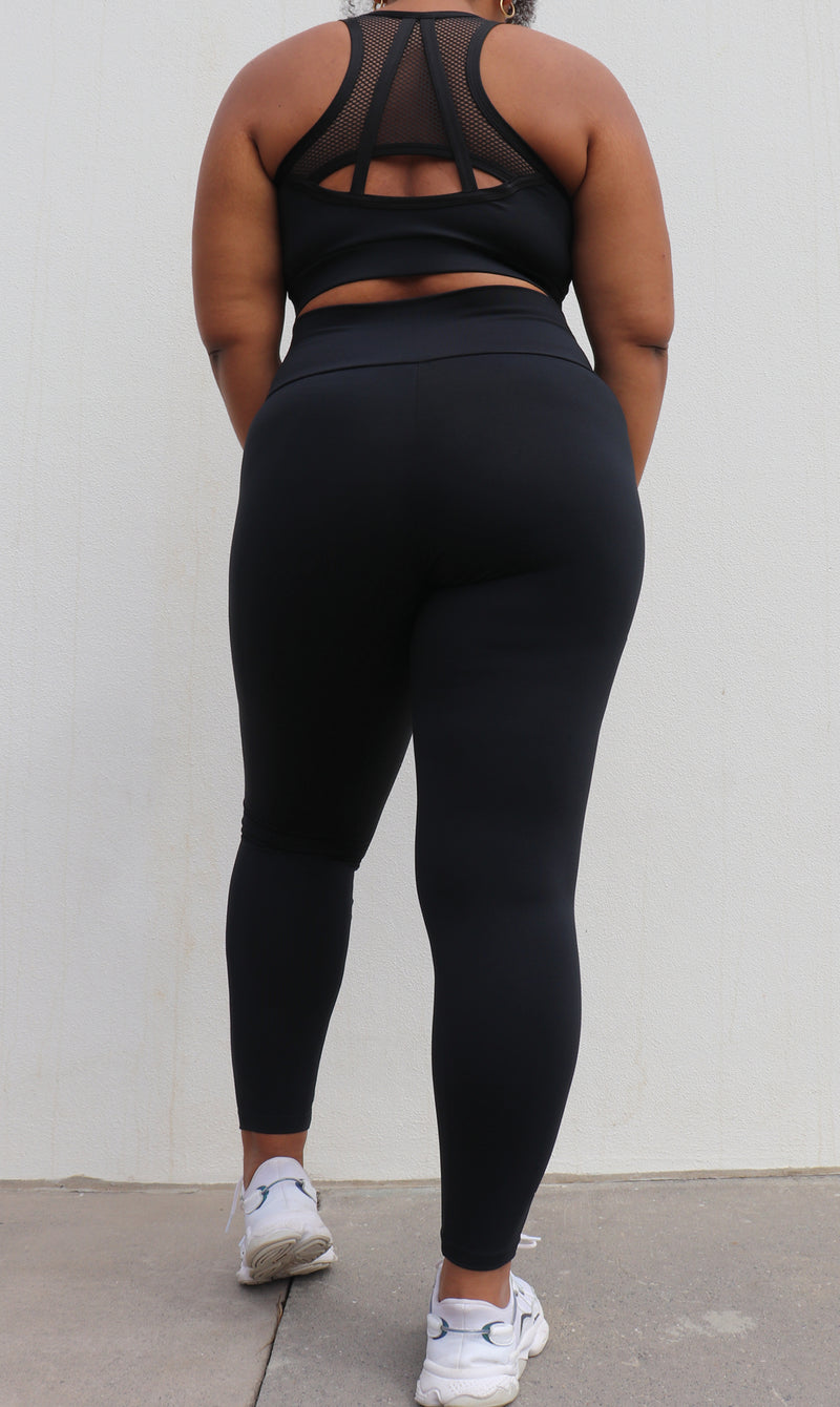 Rear View: Girl in midnight body contouring 2.0 ultra high waist leggings & matching mesh back bra