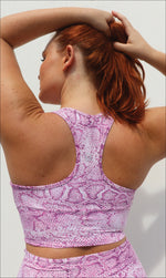Rear View: Lady wearing pink and white snake print racer back bra