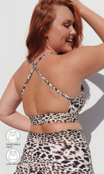 Rear view: Girl in brown & white cheetah print infinity bra with cross-over back straps